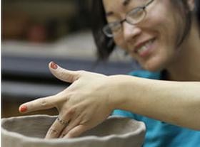 lady making pottery