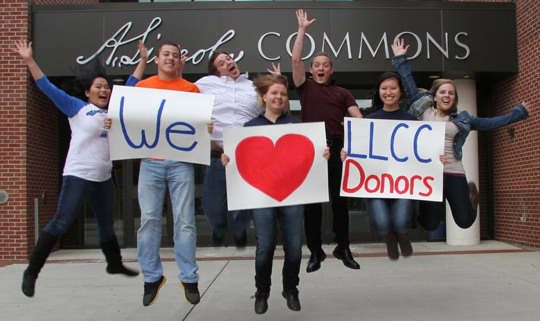Group of students holding LLCC donor signs