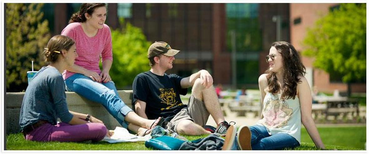 Picture of students talking in the outdoor common area